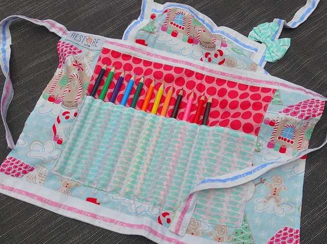 Childs apron with pencils in red dots