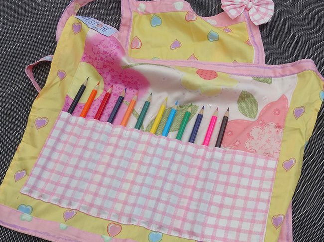Childs apron with pencils in yellow