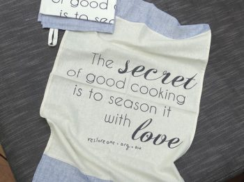 Tea Towel: The secret to good cooking is to season it with love