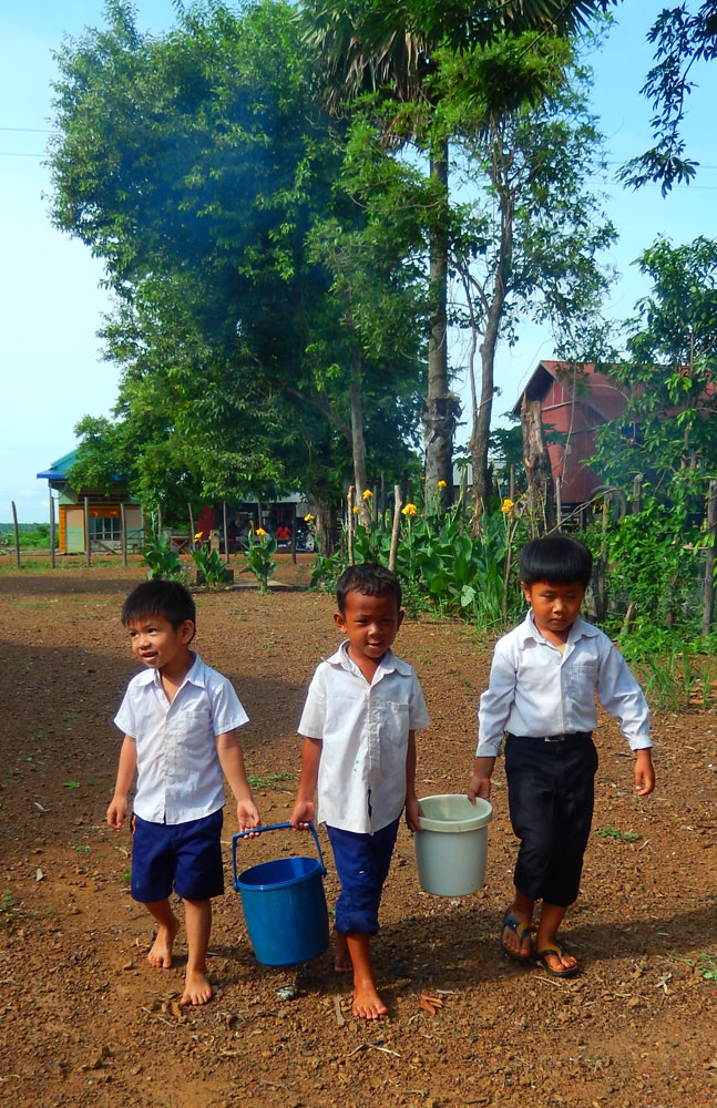 Restore One Pre School kids carrying water