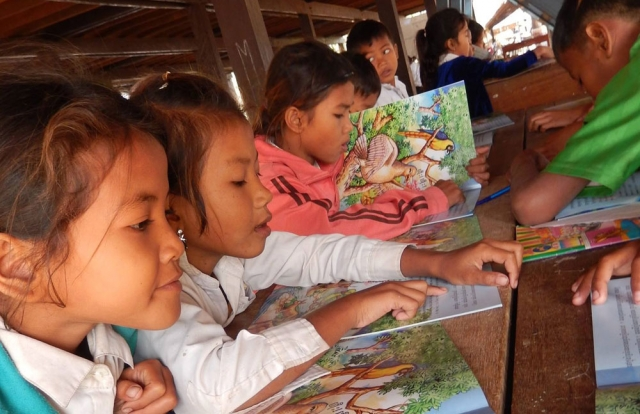 Restore One Primary School kids learning to read