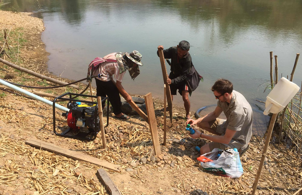 Installing the pump to bring water from the river to the tank