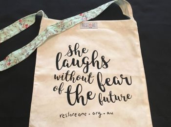 Tote bags She Laughs Without Fear